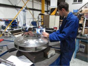 technician examining MIC